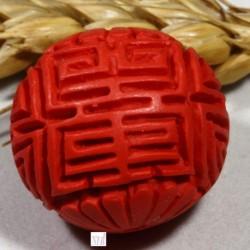 1 perle  sculptée cinabre rouge ronde 22mm