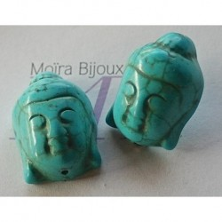 2 perles têtes  de bouddha en turquoise teintée en relief 29x20mm
